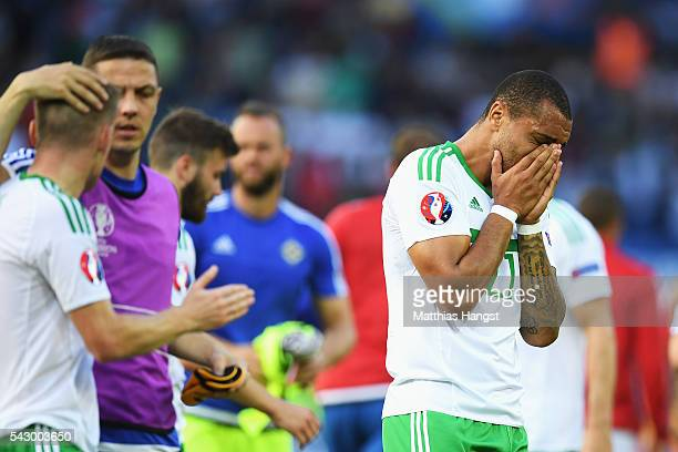 Josh Magennis of Northern Ireland shows his emotion after his team's 0-1 defeat in the UEFA EURO 2016 round of 16 match between Wales and Northern...
