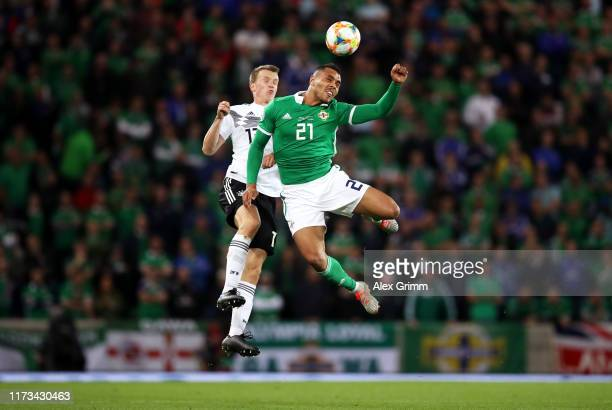 Josh Magennis of Northern Ireland wins a header over Lukas Klostermann of Germany during the UEFA Euro 2020 qualifier match between Northern Ireland...