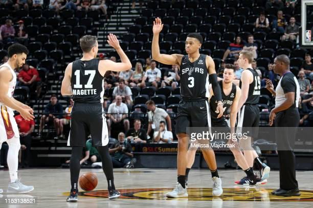 Josh Magette and Keldon Johnson of the San Antonio Spurs high five before the game against the Cleveland Cavaliers on July 1 2019 at vivintSmartHome...