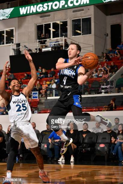 Josh Magette of the Lakeland Magic moves the ball against Trevon Duval of the Iowa Wolves during the game on January 18 2020 at the RP Funding Center...