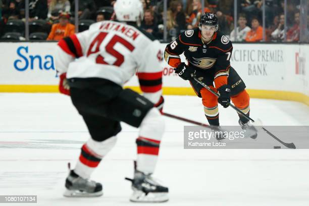 Josh Mahura of the Anaheim Ducks looks to maintain control of the puck as Sami Vatanen of the New Jersey Devils heads him off at Honda Center on...