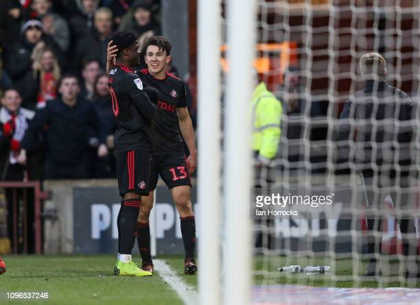 Josh Maja and Luke O'Nien of Sunderland celebrate the first goal during the Sky Bet League One match between Scunthorpe United and Sunderland at...