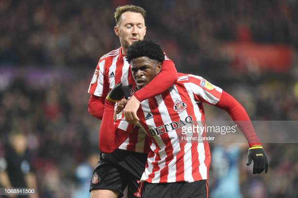 Josh Maja of Sunderland celebrates with teammate Aiden McGeady after scoring his team's first goal during the Sky Bet League One match between...