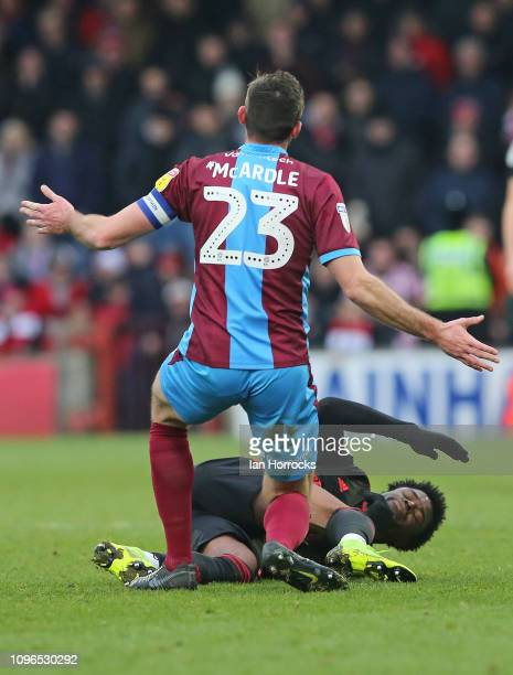 Josh Maja of Sunderland is brought down by Rory McArdle of Scunthorpe during the Sky Bet League One match between Scunthorpe United and Sunderland at...
