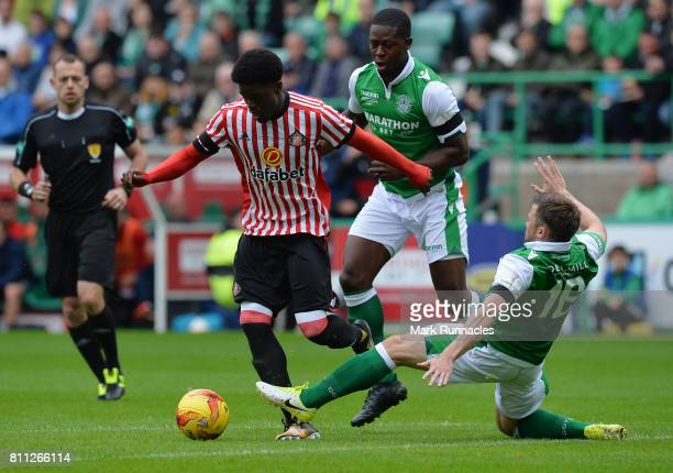 Josh Maja of Sunderland is tackled by Marvin Bartley and Lewis Stevenson of Hibernian during the pre season friendly between Hibernian and Sunderland...