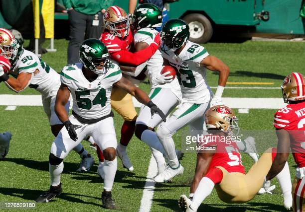Josh Malone and Avery Williamson of the New York Jets in action against the San Francisco 49ers at MetLife Stadium on September 20, 2020 in East...