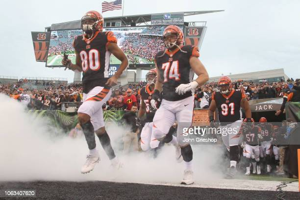 Josh Malone and Jake Fisher of the Cincinnati Bengals take the field for their game against the Tampa Bay Bucccaneers at Paul Brown Stadium on...