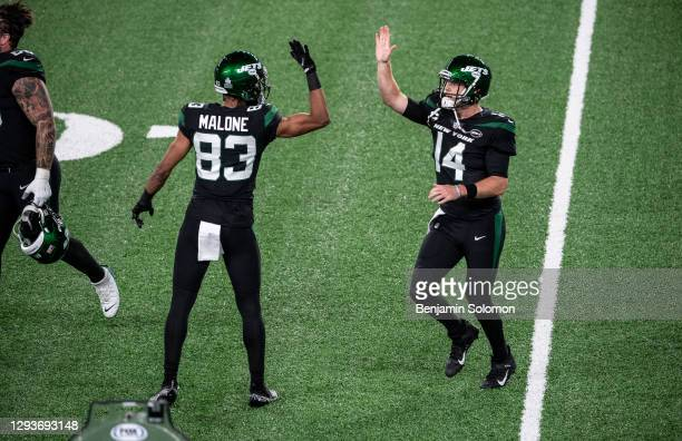 Josh Malone and Sam Darnold of the New York Jets high five during a game against the Denver Broncos at MetLife Stadium on October 1, 2020 in East...