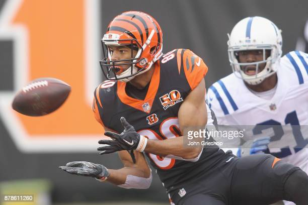 Josh Malone of the Cincinnati Bengals hauls in the touchdown pass in front of Vontae Davis of the Indianapolis Colts during their game at Paul Brown...