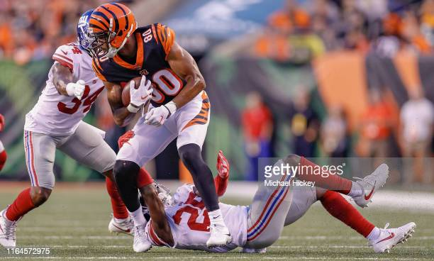Josh Malone of the Cincinnati Bengals runs the ball during the preseason game against the New York Giants at Paul Brown Stadium on August 22, 2019 in...