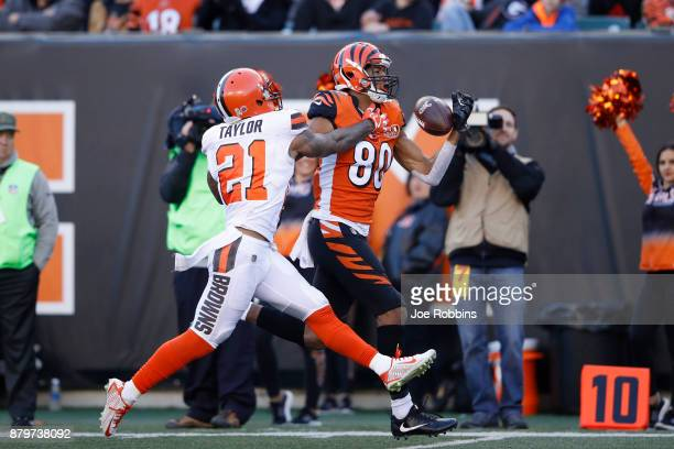 Josh Malone of the Cincinnati Bengals tries to make a one-handed catch against Jamar Taylor of the Cleveland Browns in the second half of a game at...