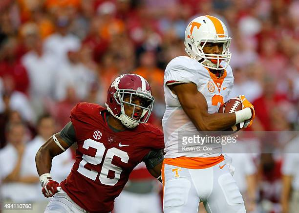Josh Malone of the Tennessee Volunteers pulls in this reception against Marlon Humphrey of the Alabama Crimson Tide at Bryant-Denny Stadium on...