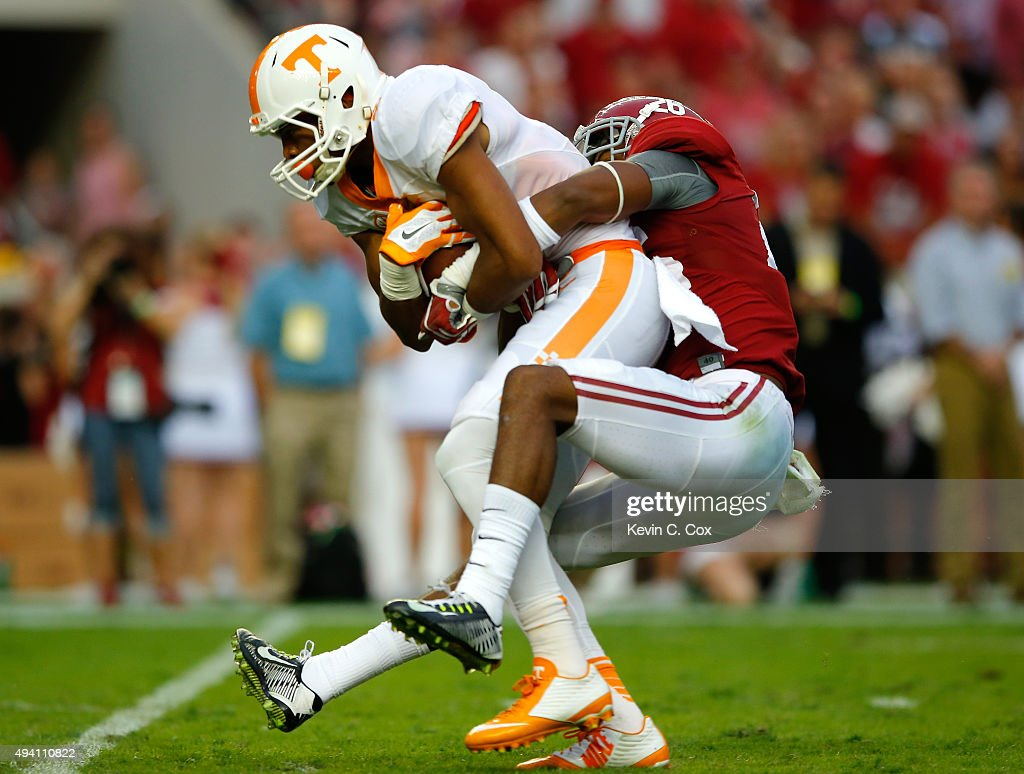 Josh Malone #3 of the Tennessee Volunteers pulls in this reception against Marlon Humphrey #26 of the Alabama Crimson Tide at Bryant-Denny Stadium on October 24, 2015 in Tuscaloosa, Alabama.