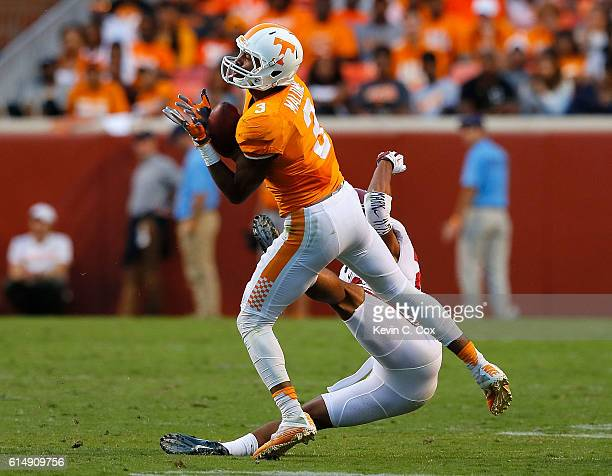Josh Malone of the Tennessee Volunteers pulls in this reception against Minkah Fitzpatrick of the Alabama Crimson Tide at Neyland Stadium on October...