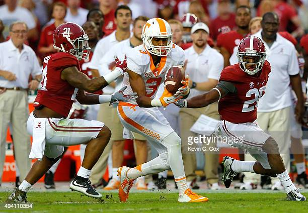 Josh Malone of the Tennessee Volunteers pulls in this reception against Maurice Smith and Marlon Humphrey of the Alabama Crimson Tide at Bryant-Denny...