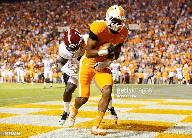 Josh Malone of the Tennessee Volunteers pulls in this touchdown reception against Tony Brown of the Alabama Crimson Tide at Neyland Stadium on...