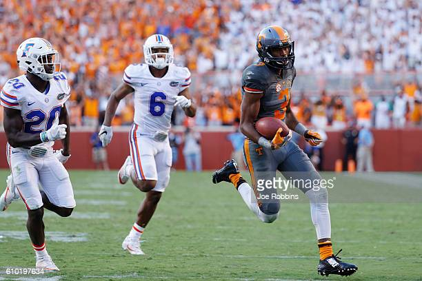 Josh Malone of the Tennessee Volunteers runs into the end zone with a 42-yard touchdown reception against the Florida Gators in the fourth quarter at...