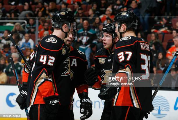 Josh Manson Adam Henrique Ondrej Kase and Nick Ritchie of the Anaheim Ducks talk while waiting for play to resume during the second period of the...