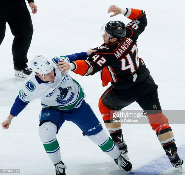 Josh Manson of the Anaheim Ducks battles in a fight against Derek Dorsett of the Vancouver Canucks during the game on November 9 2017 at Honda Center...