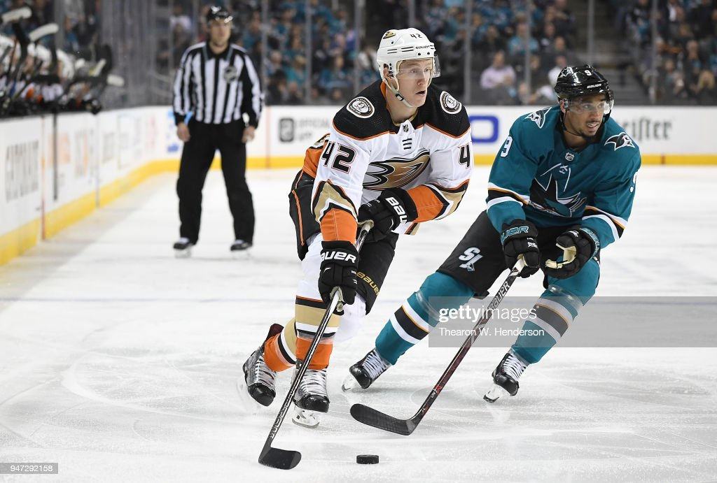 Josh Manson #42 of the Anaheim Ducks skates up ice with control of the puck pursued by Evander Kane #9 of the San Jose Sharks during the third period in Game Three of the Western Conference First Round during the 2018 NHL Stanley Cup Playoffs at SAP Center on April 16, 2018 in San Jose, California.