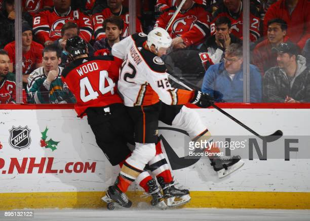 Josh Manson of the Anaheim Ducks steps into Miles Wood of the New Jersey Devils during the second period at the Prudential Center on December 18 2017...