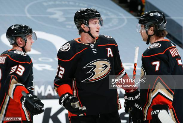Josh Manson of the Anaheim Ducks talks with Ben Hutton during his 400th career NHL game against the Colorado Avalanche at Honda Center on April 09,...