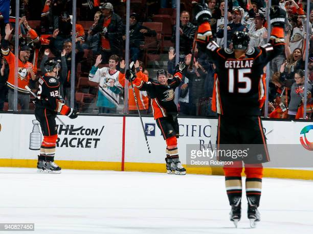 Josh Manson Ondrej Kase and Ryan Getzlaf of the Anaheim Ducks celebrate Kase's overtime goal as the Ducks defeat the Colorado Avalanche 43 in the...