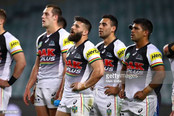 Josh Mansour and Tyrone Peachey of the Panthers and their team mates look dejected after an Eagles try during the NRL Elimination Final match between...
