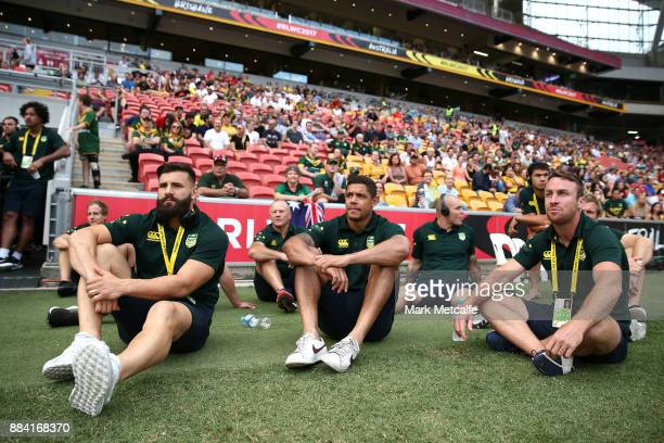 Josh Mansour Dane Gagai and James Maloney of the Kangaroos watch the 2017 Rugby League Women's World Cup Final between Australia and New Zealand at...