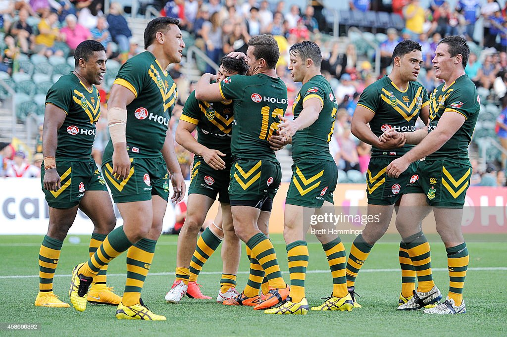 Josh Mansour of Australia celebrates scoring a try with team mates during the Four Nations match between the Australian Kangaroos and Samoa at WIN Stadium on November 9, 2014 in Wollongong, Australia.