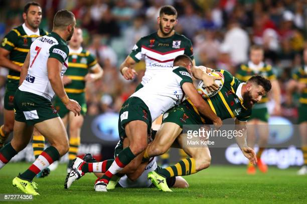 Josh Mansour of Australia is tackled during the 2017 Rugby League World Cup match between Australia and Lebanon at Allianz Stadium on November 11...