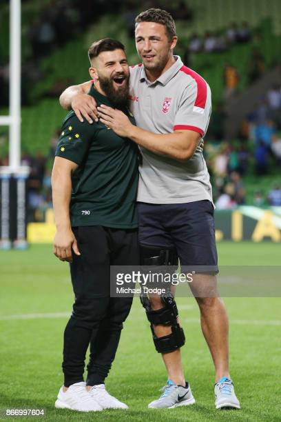 Josh Mansour of the Kangaroos consoles the defeated and injured Sam Burgess of England during the 2017 Rugby League World Cup match between the...