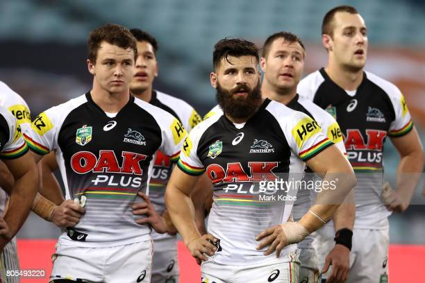 Josh Mansour of the Panthers and team mates look dejected after a Rabbitohs try during the round 17 NRL match between the South Sydney Rabbitohs and...