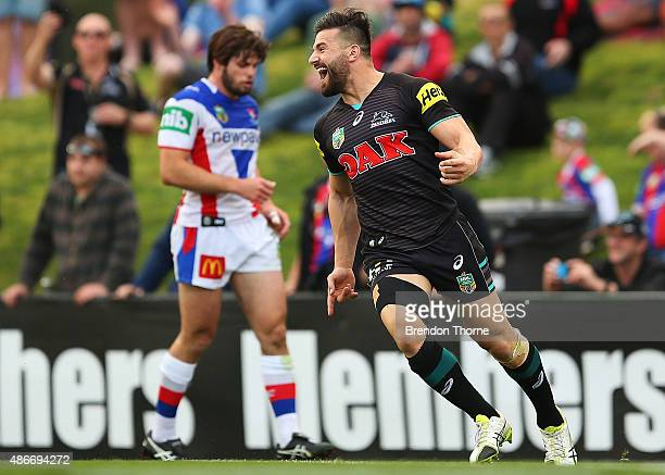 Josh Mansour of the Panthers celebrates after scoring a try during the round 26 NRL match between the Penrith Panthers and the Newcastle Knights at...