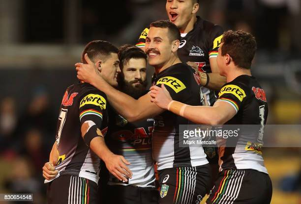 Josh Mansour of the Panthers celebrates scoring a try with team mates during the round 23 NRL match between the Penrith Panthers and the North...