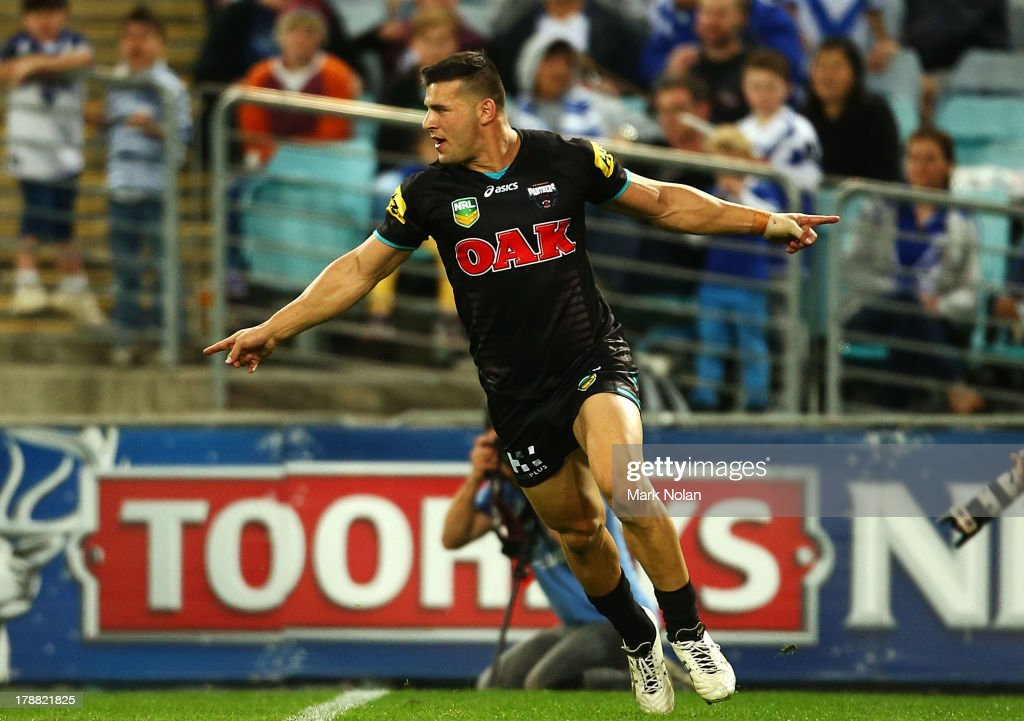 Josh Mansour of the Panthers celebrates scoring during the round 25 NRL match between the Canterbury Bulldogs and the Penrith Panthers at ANZ Stadium on August 31, 2013 in Sydney, Australia.