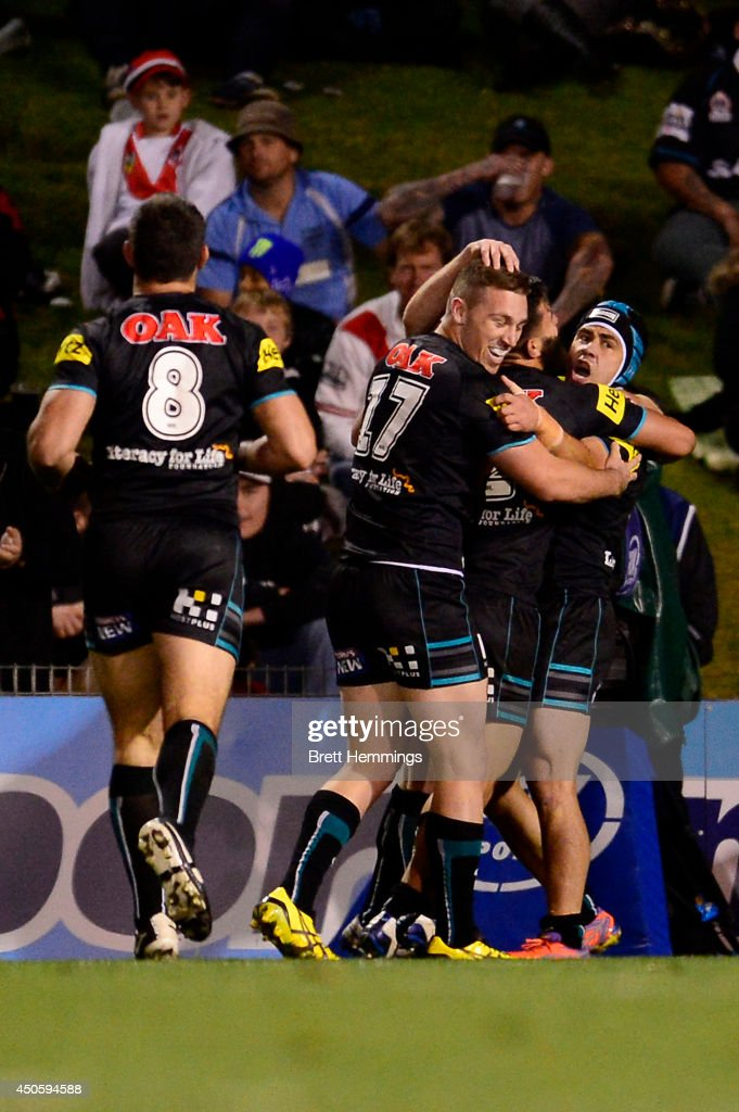 Josh Mansour of the Panthers celebrates with team mates after scoring during the round 14 NRL match between the Penrith Panthers and the St George Illawarra Dragons at Sportingbet Stadium on June 14, 2014 in Sydney, Australia.