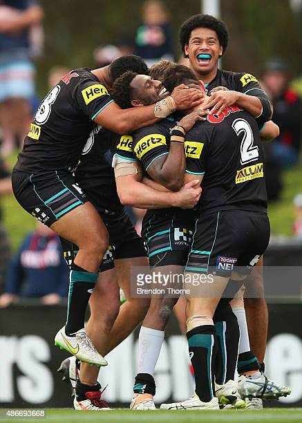 Josh Mansour of the Panthers celebrates with team mates after scoring a try during the round 26 NRL match between the Penrith Panthers and the...