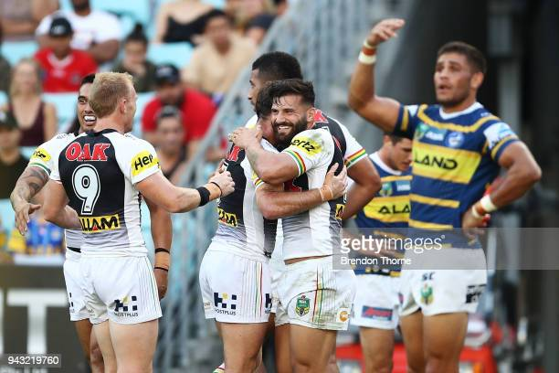 Josh Mansour of the Panthers celebrates with team mates after scoring a try during the round five NRL match between the Parramatta Eels and the...