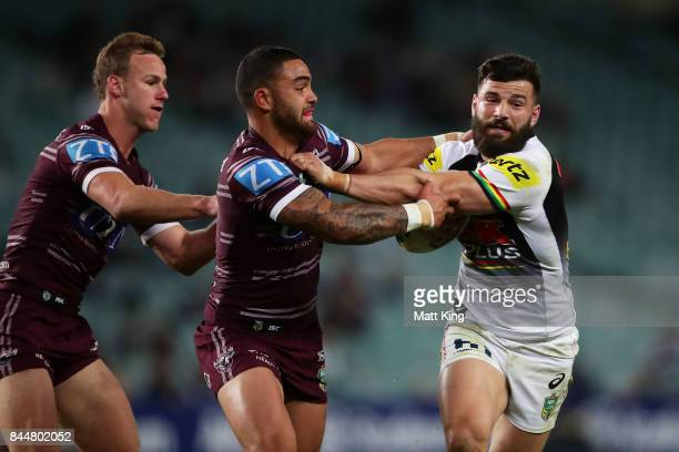 Josh Mansour of the Panthers is tackled by Dylan Walker of the Sea Eagles during the NRL Elimination Final match between the Manly Sea Eagles and the...