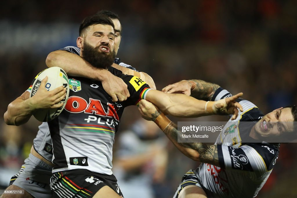 Josh Mansour of the Panthers is tackled by Kane Linnett of the Cowboys during the round 23 NRL match between the Penrith Panthers and the North Queensland Cowboys at Pepper Stadium on August 12, 2017 in Sydney, Australia.