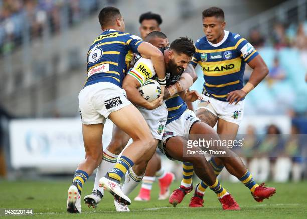Josh Mansour of the Panthers is tackled by the Eels defence during the round five NRL match between the Parramatta Eels and the Penrith Panthers at...