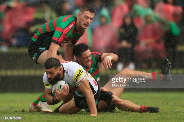 Josh Mansour of the Panthers is tackled during the NRL trial match between the South Sydney Rabbitohs and the Penrith Panthers at Redfern Oval on...