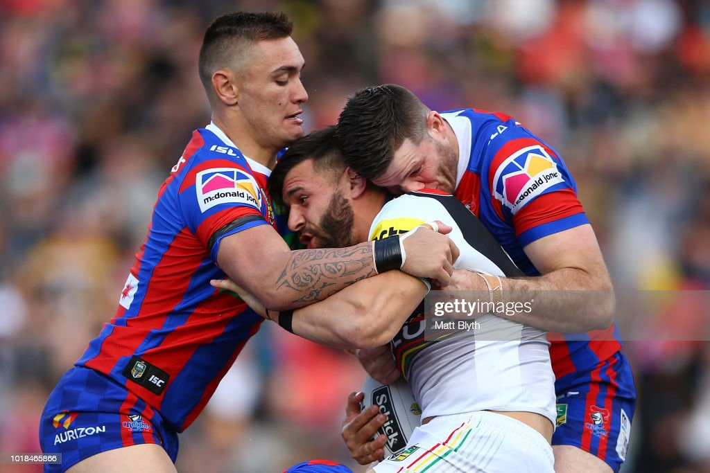 Josh Mansour of the Panthers is tackled during the round 23 NRL match between the Penrith Panthers and the Newcastle Knights at Panthers Stadium on August 18, 2018 in Sydney, Australia.