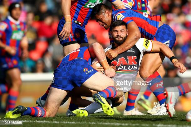 Josh Mansour of the Panthers is tackled during the round 23 NRL match between the Penrith Panthers and the Newcastle Knights at Panthers Stadium on...