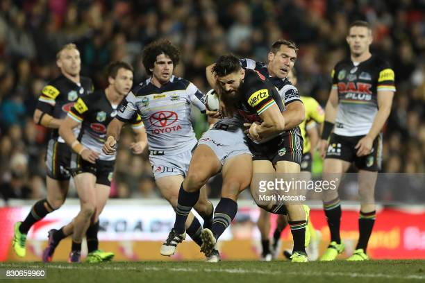 Josh Mansour of the Panthers is tackled during the round 23 NRL match between the Penrith Panthers and the North Queensland Cowboys at Pepper Stadium...