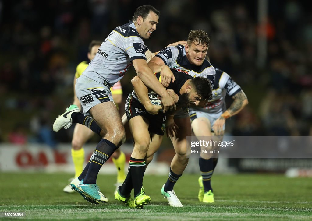 Josh Mansour of the Panthers is tackled during the round 23 NRL match between the Penrith Panthers and the North Queensland Cowboys at Pepper Stadium on August 12, 2017 in Sydney, Australia.
