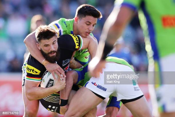 Josh Mansour of the Panthers is tackled during the round 24 NRL match between the Canberra Raiders and the Penrith Panthers at GIO Stadium on August...