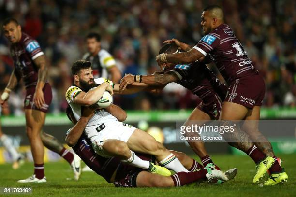 Josh Mansour of the Panthers is tackled during the round 26 NRL match between the Manly Sea Eagles and the Penrith Panthers at Lottoland on September...
