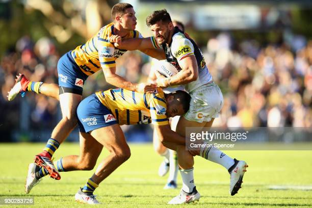 Josh Mansour of the Panthers is tackled during the round one NRL match between the Penrith Panthers and the Parramatta Eels at Panthers Stadium on...